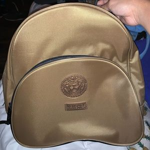 Gold versace perfume backpack